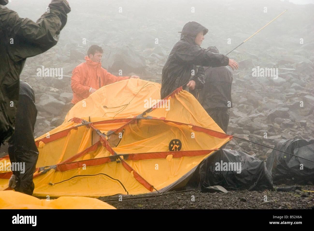 Backpackers put up tent in the rain Lost Lake Chugach National Forest Kenai Peninsula Alaska summer & Backpackers put up tent in the rain Lost Lake Chugach National ...