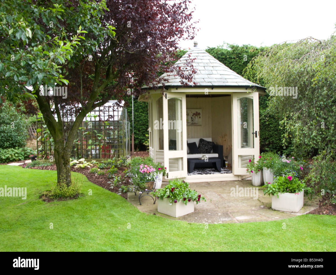 Summer house in a small garden stock photo royalty free for Garden designs with summer house