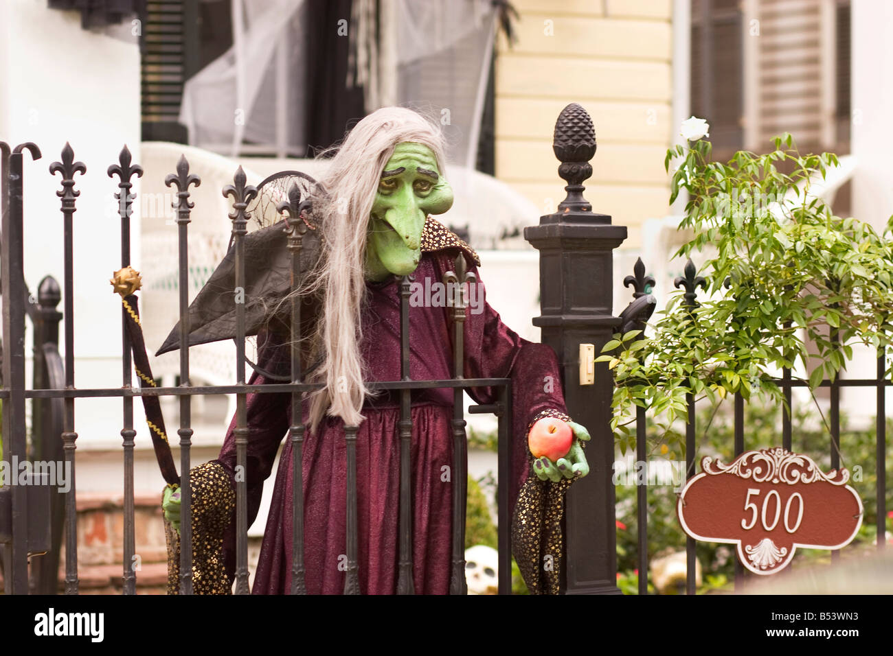 halloween witch waits for trick or treaters at the front gate of a usa home - Frontgate Halloween