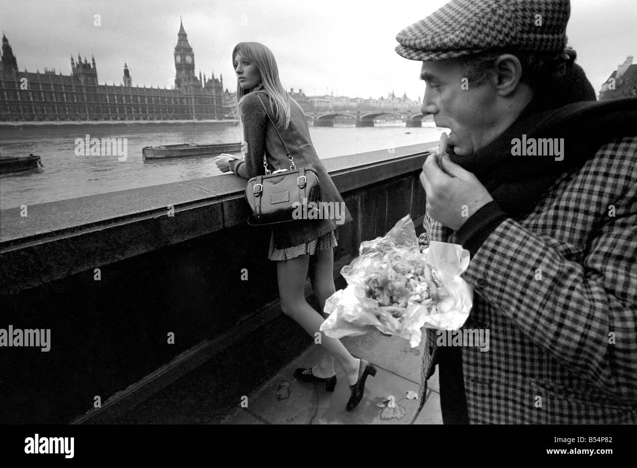Places london england a man eating fish and chips for Places that sell fish near me