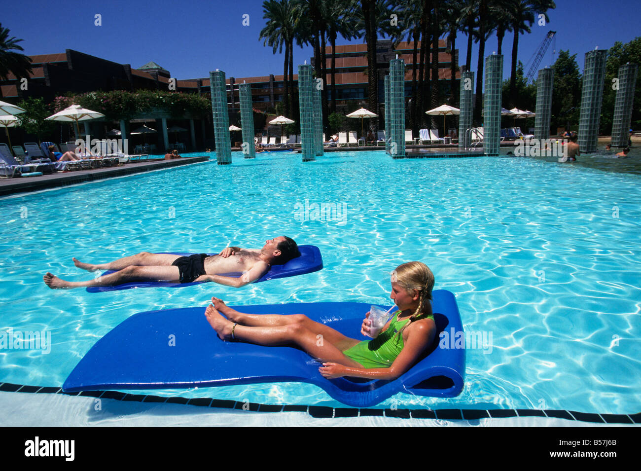 Hotel pool with people  People relax in the large swimming pool of a 5 star luxury hotel ...