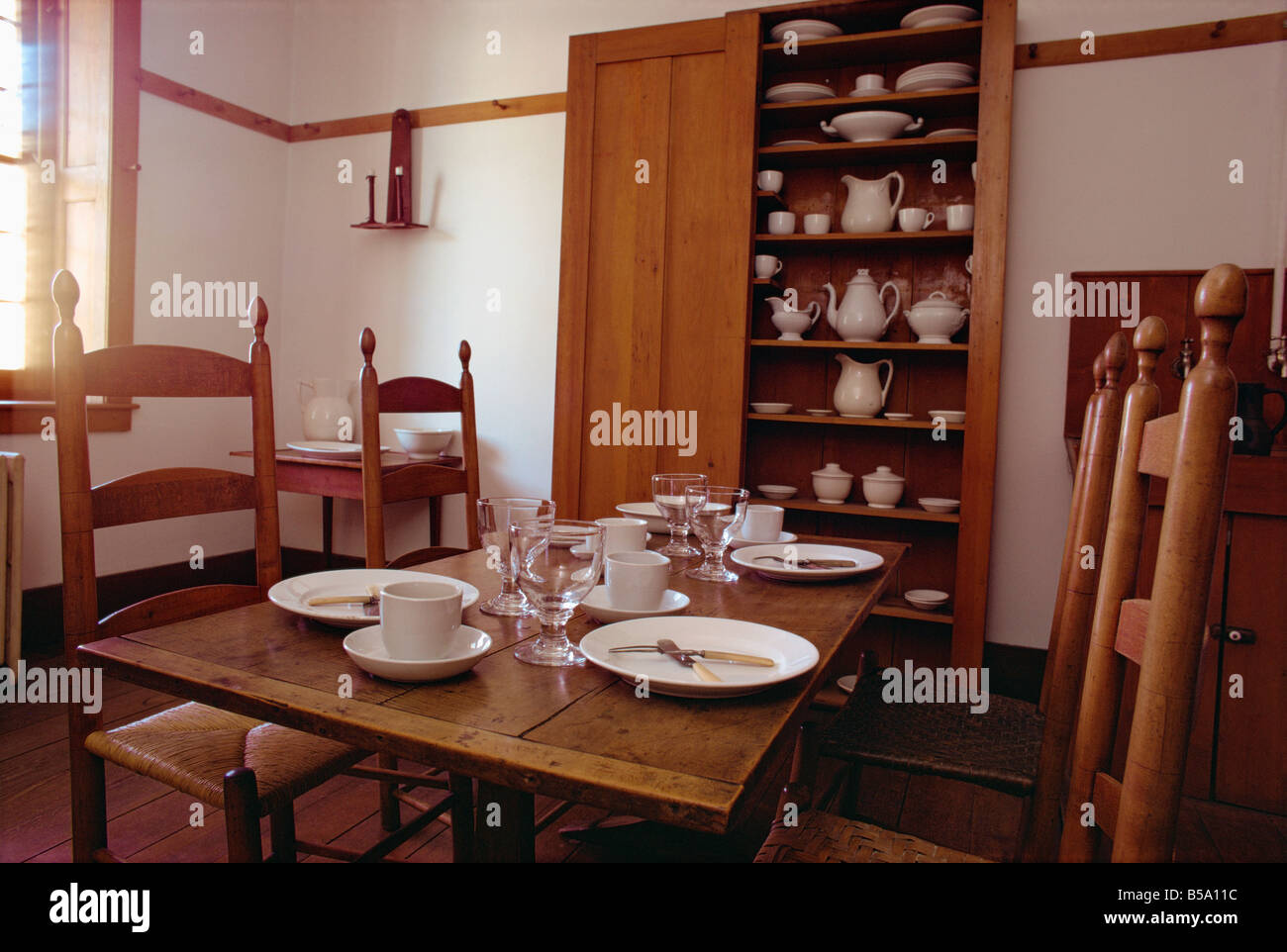 interior with table chairs white china and cupboard in the shaker