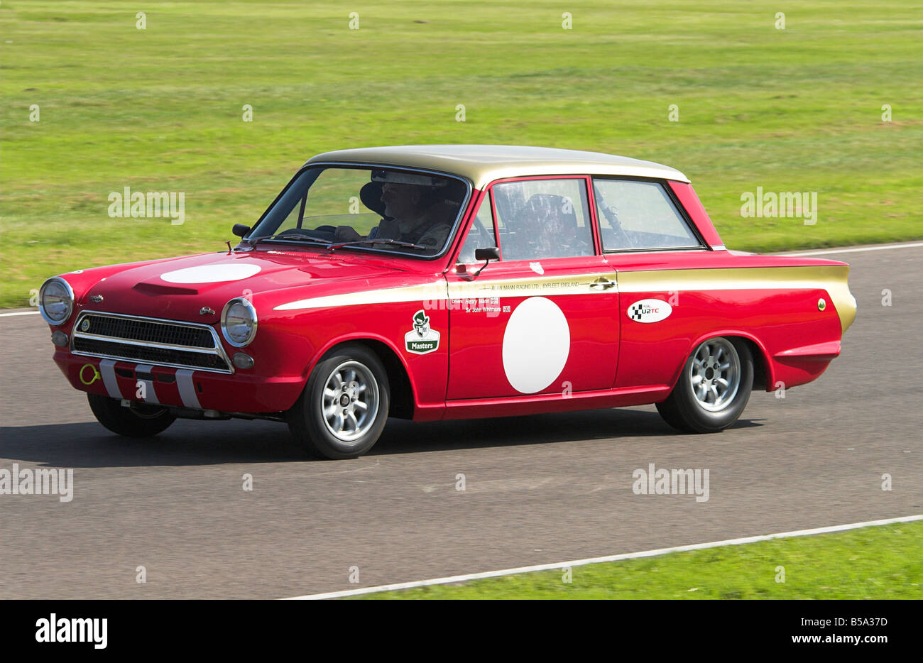 1965 ford lotus cortina mk1 in the racing at goodwood revival stock image