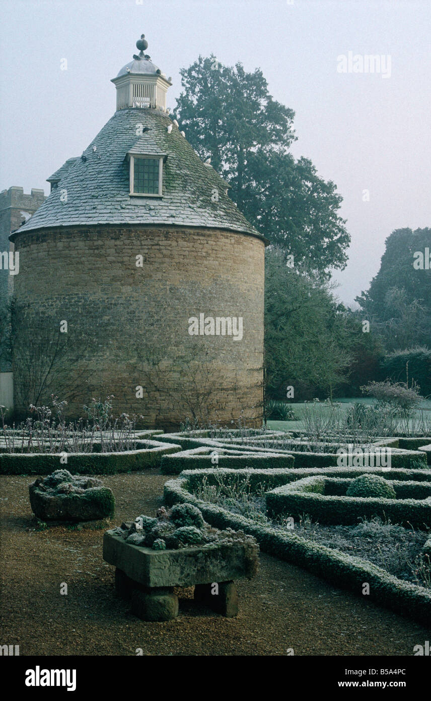 Stately Home Gardens Winter Frosted Box Hedges Paths Mist Historic Circular Dovecote Building ROUSHAM PARK OXFORDSHIRE ENGLAND