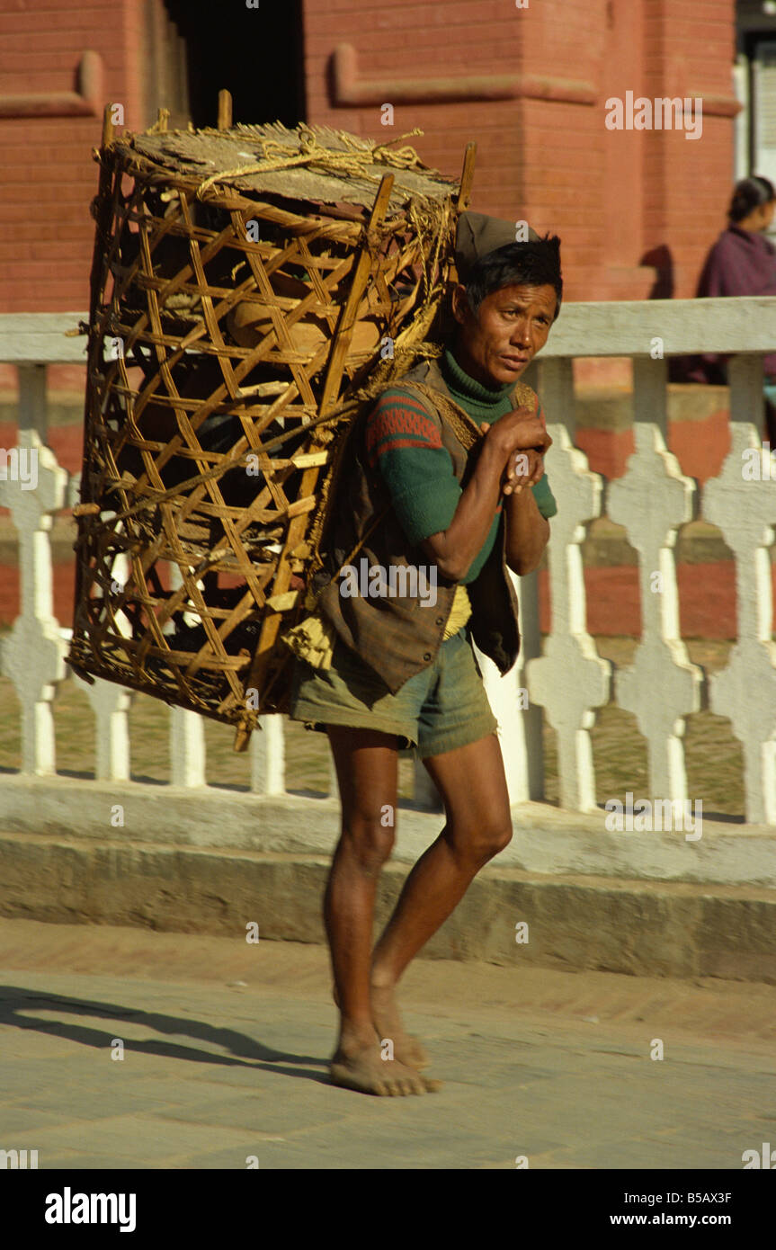 Man working as a porter carrying a wicker basket near for Men a porter