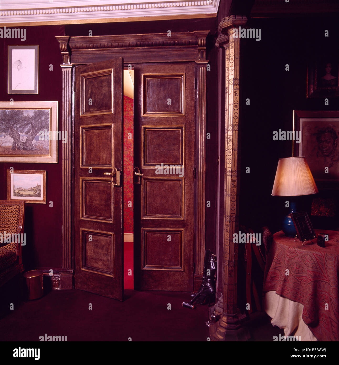 Panelled Double Doors With Paint Effect Graining In Dark Dining Room Lighted Lamp On Small Table