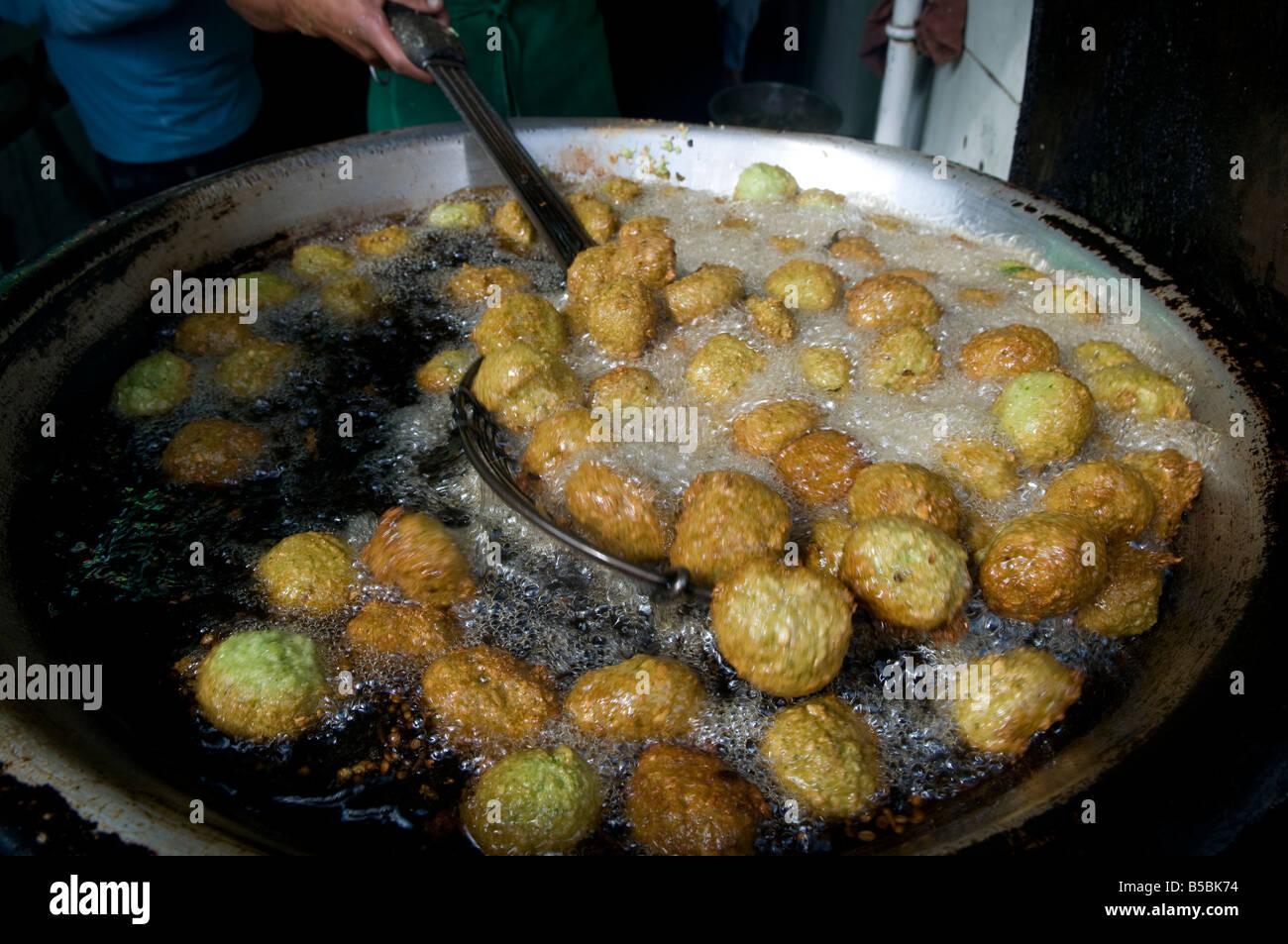Taamiya or falafel balls being prepared at an egyptian - Cuisine bernard falafel ...