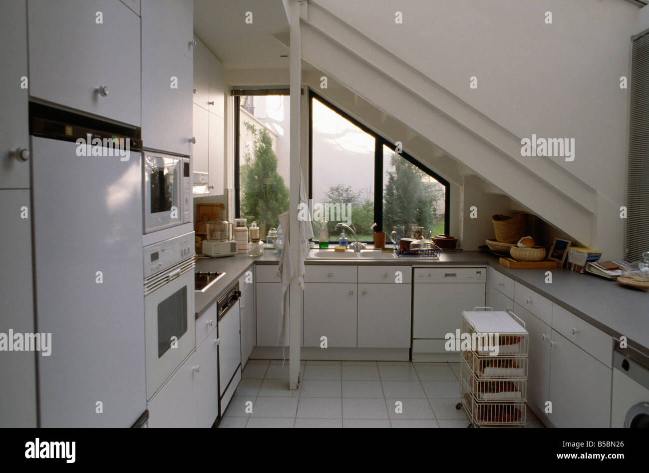 interiors kitchen stairs white stock photos & interiors kitchen