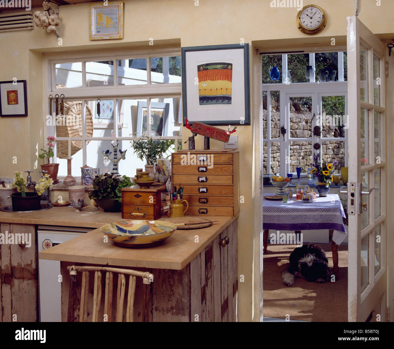 Rustic Wooden Units And Worktop In Cottage Kitchen With Glazed
