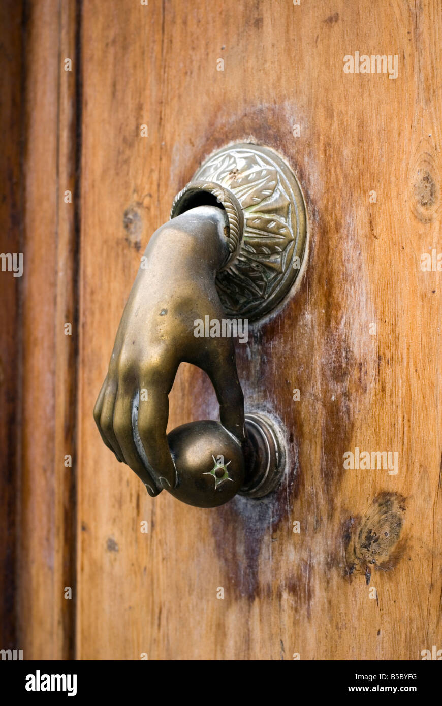 Good Old Brass Door Knocker Of Hand Holding An Orange In Calle Caballeros In The  Historical El Carmen City Centre Of Valencia Spain