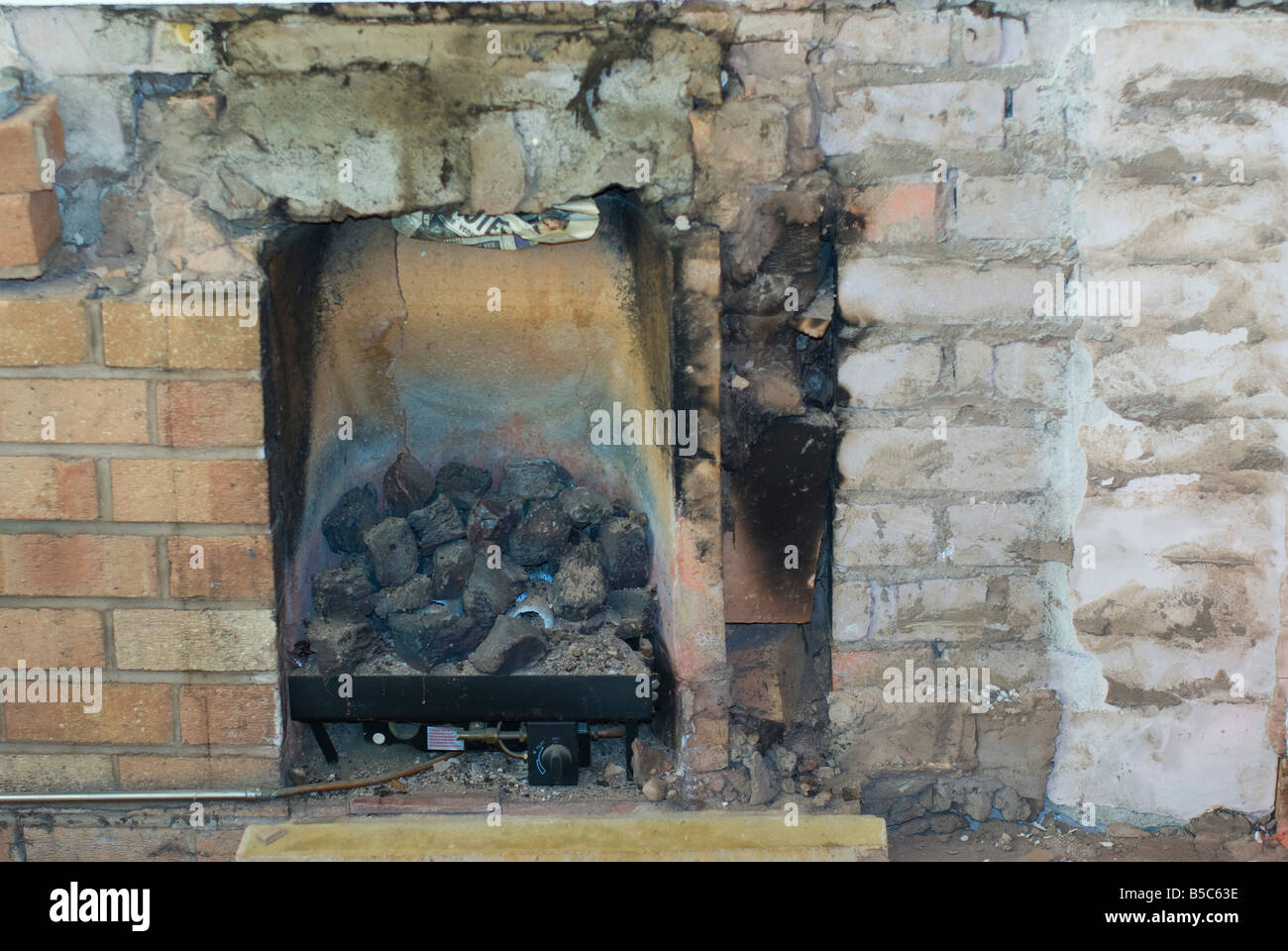 condemed Coal effect gas fire with soot and blocked