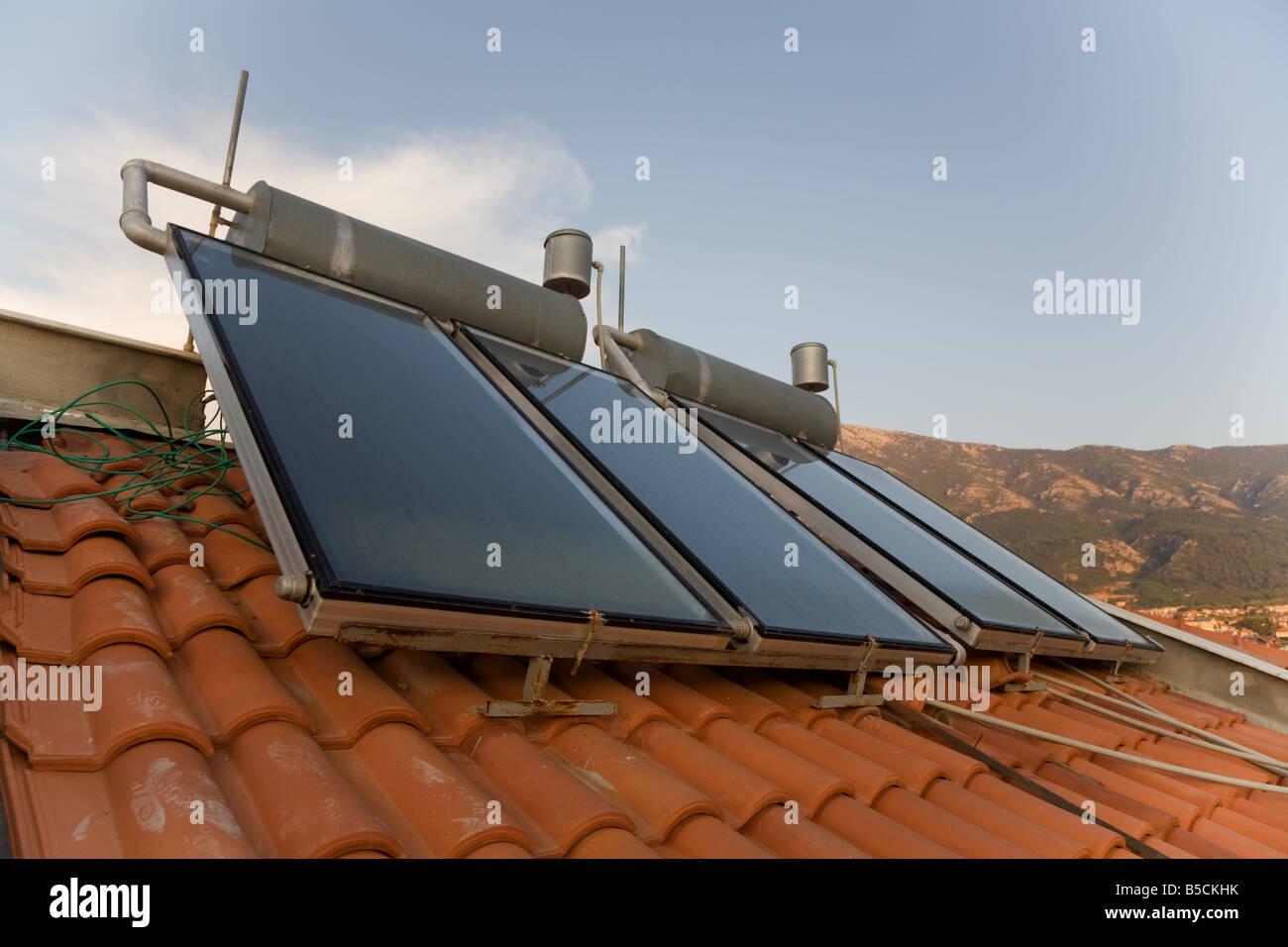 Solar panels, renewable energy on terracotta roof tiles in Hisaronu, near  Fethiye Turkey