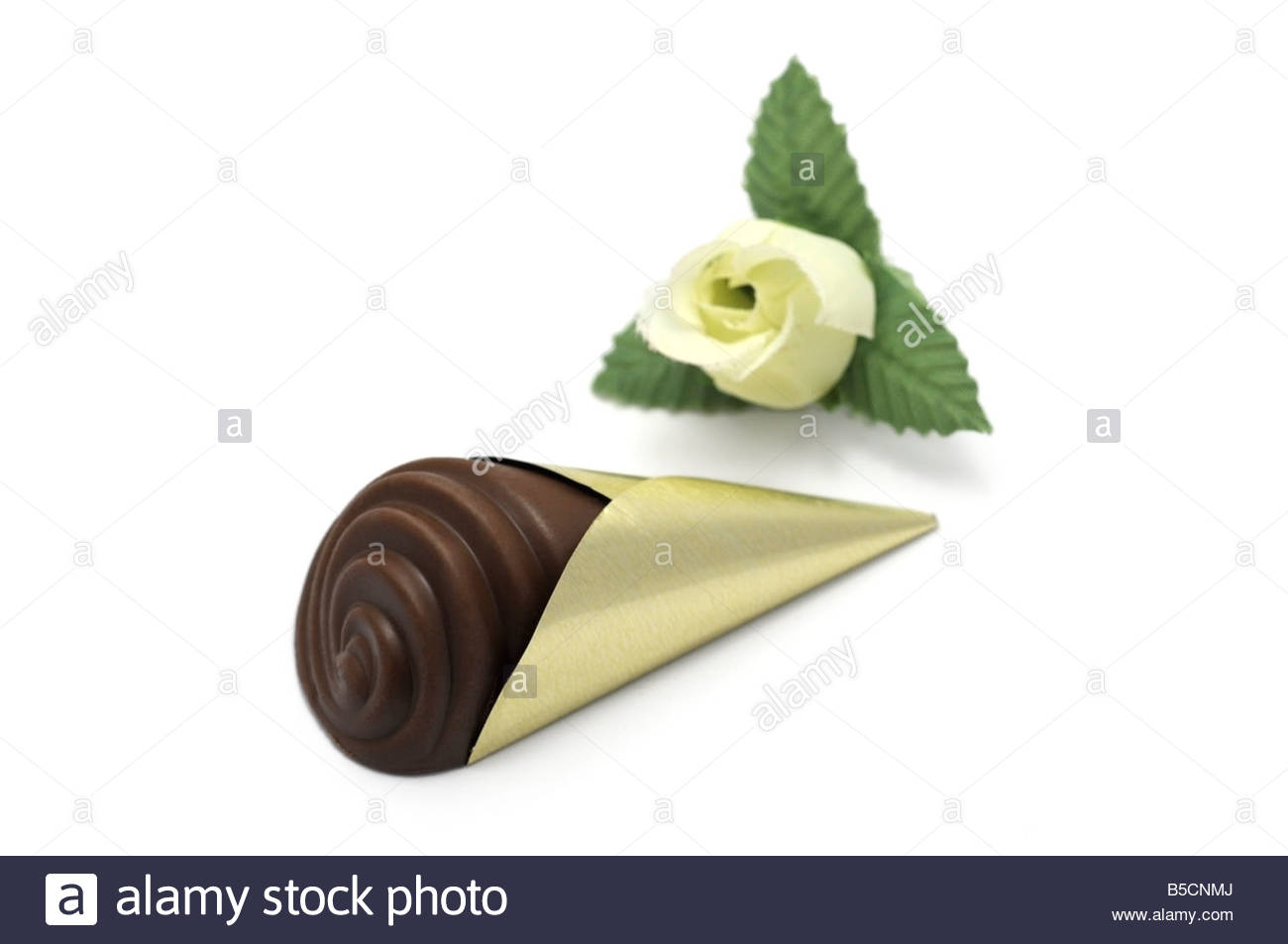 Single Chocolate in gold coloured wrapping Stock Photo, Royalty ...