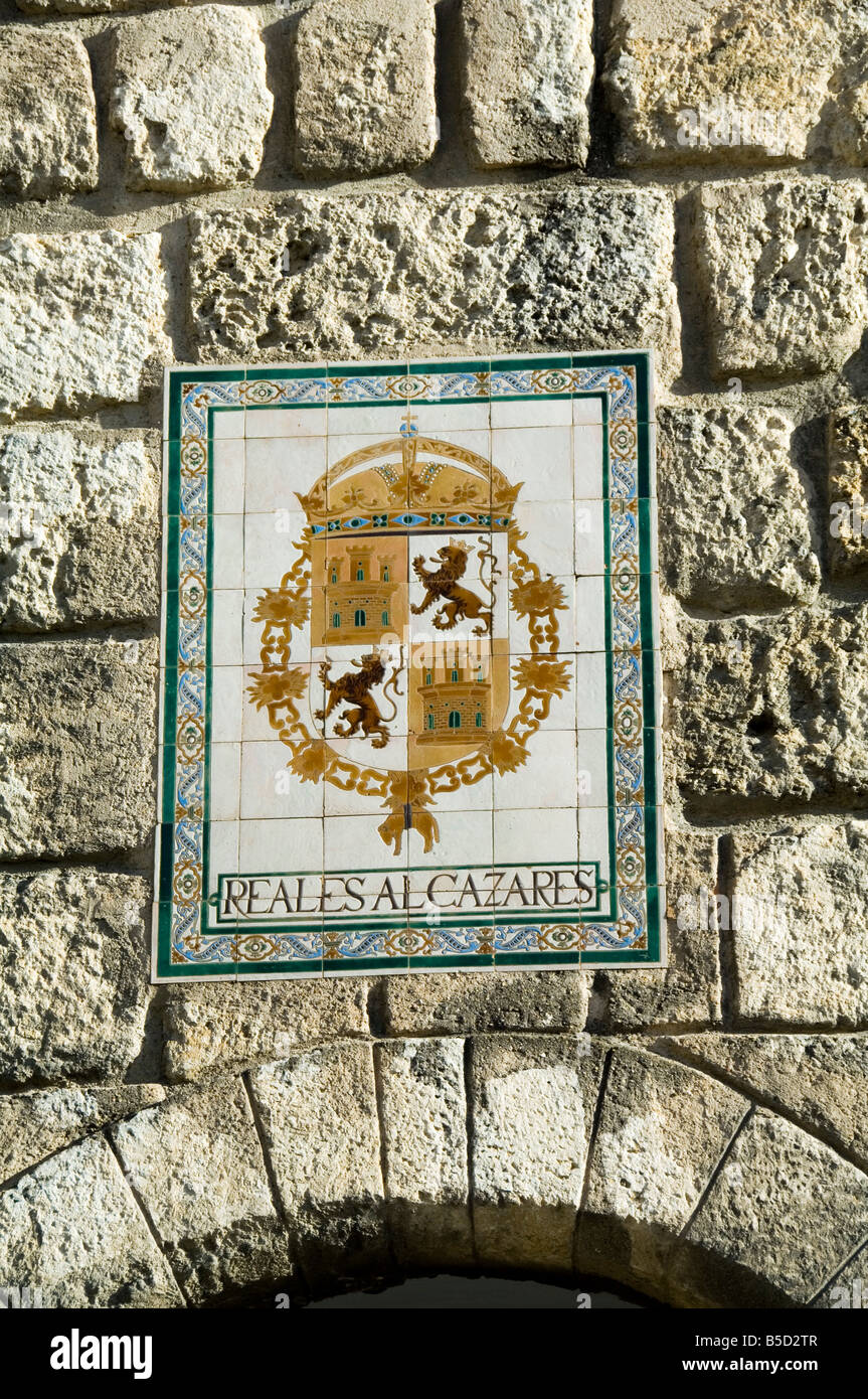 Elegant Detail Of Coat Of Arms On Outer Wall Of The Real Alcazar Just Outside The  Exit, Santa Cruz District, Seville, Andalusia, Spain