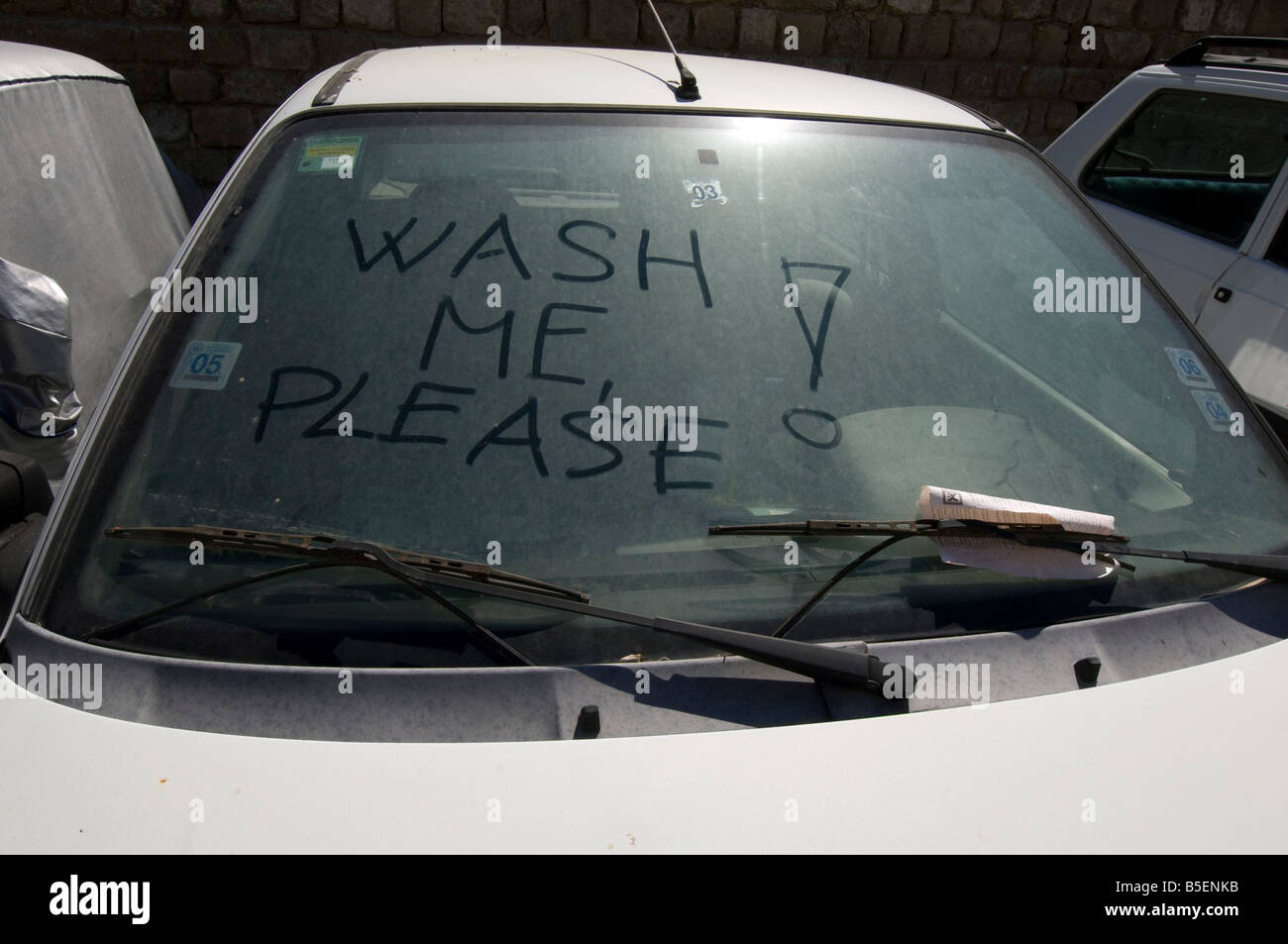 A Wash Me Please Inscription Plea Written On The Filthy