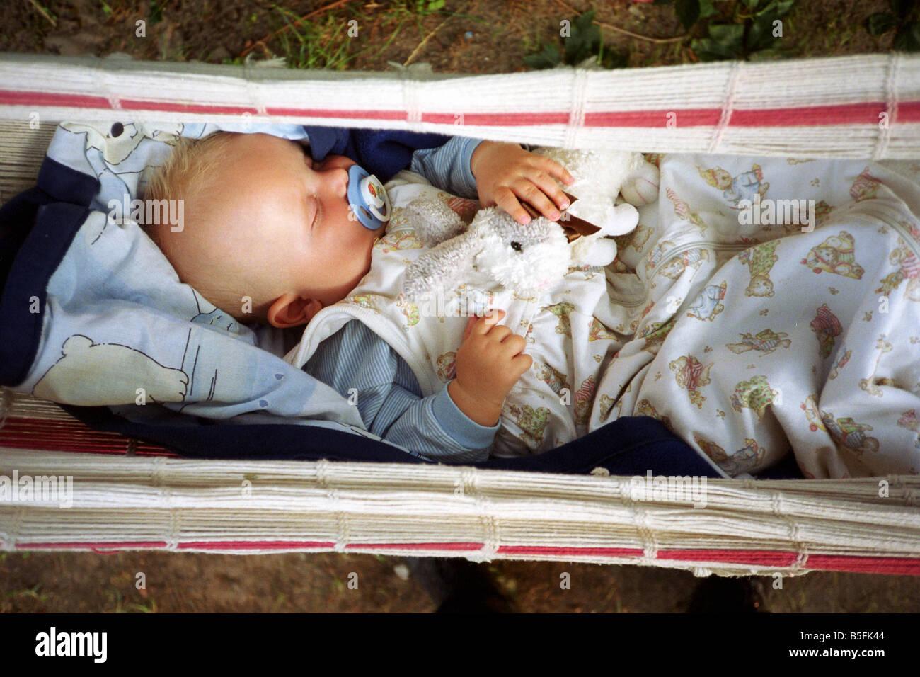baby sleeping in a hammock baby sleeping in a hammock stock photo royalty free image      rh   alamy