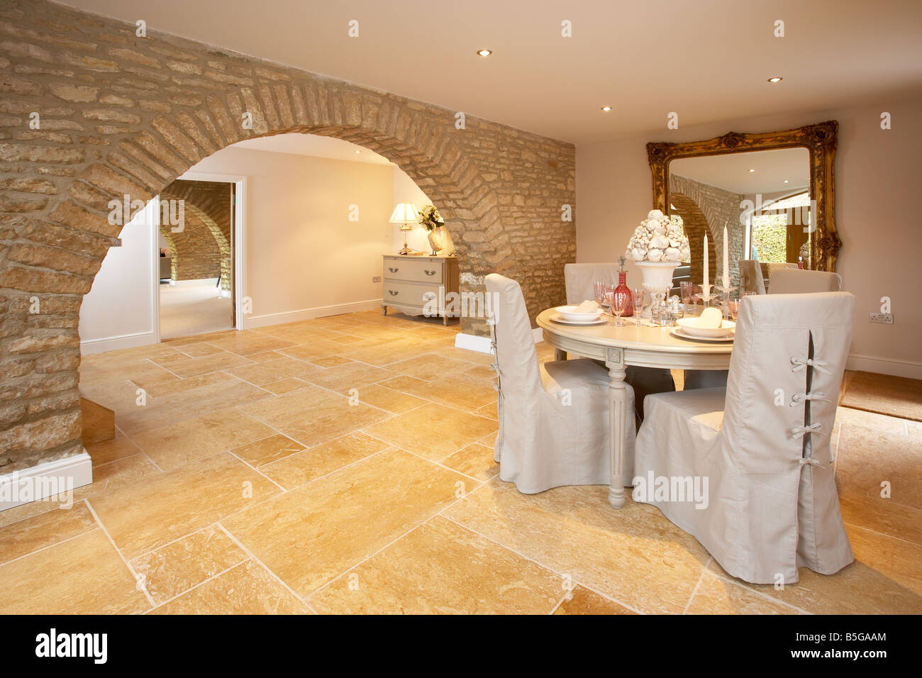 dining room in modern cotswold barn conversion with limestone