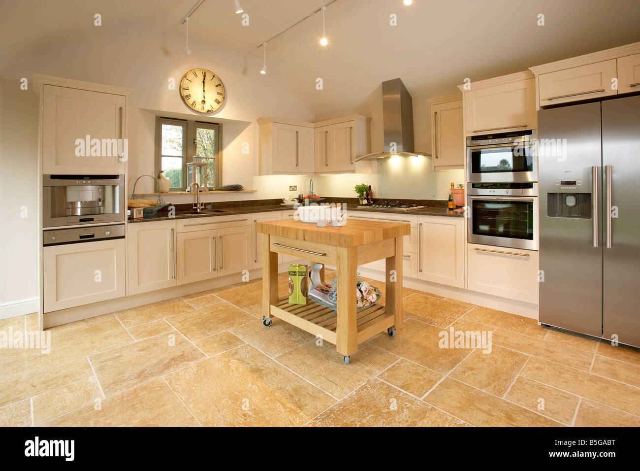 Modern Shaker Style Kitchen With Limestone Floor Butchers