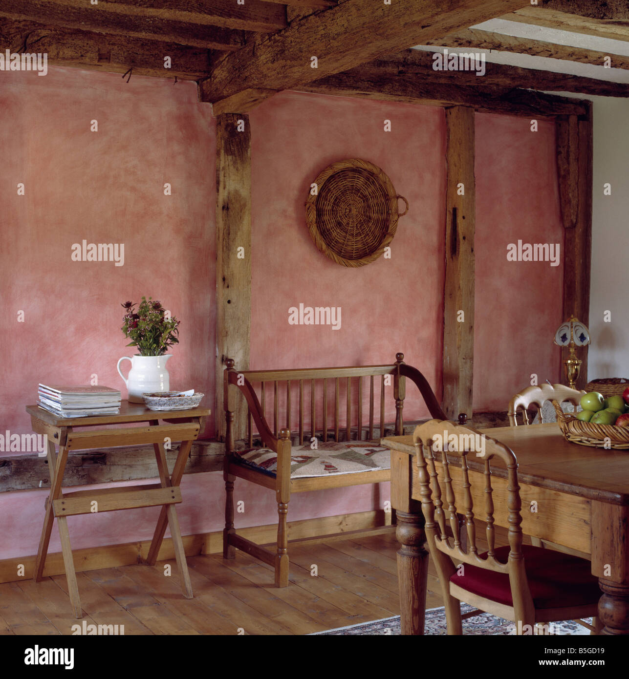 Terracotta paint effect sponged walls in cottage dining room with wooden  chairs and table