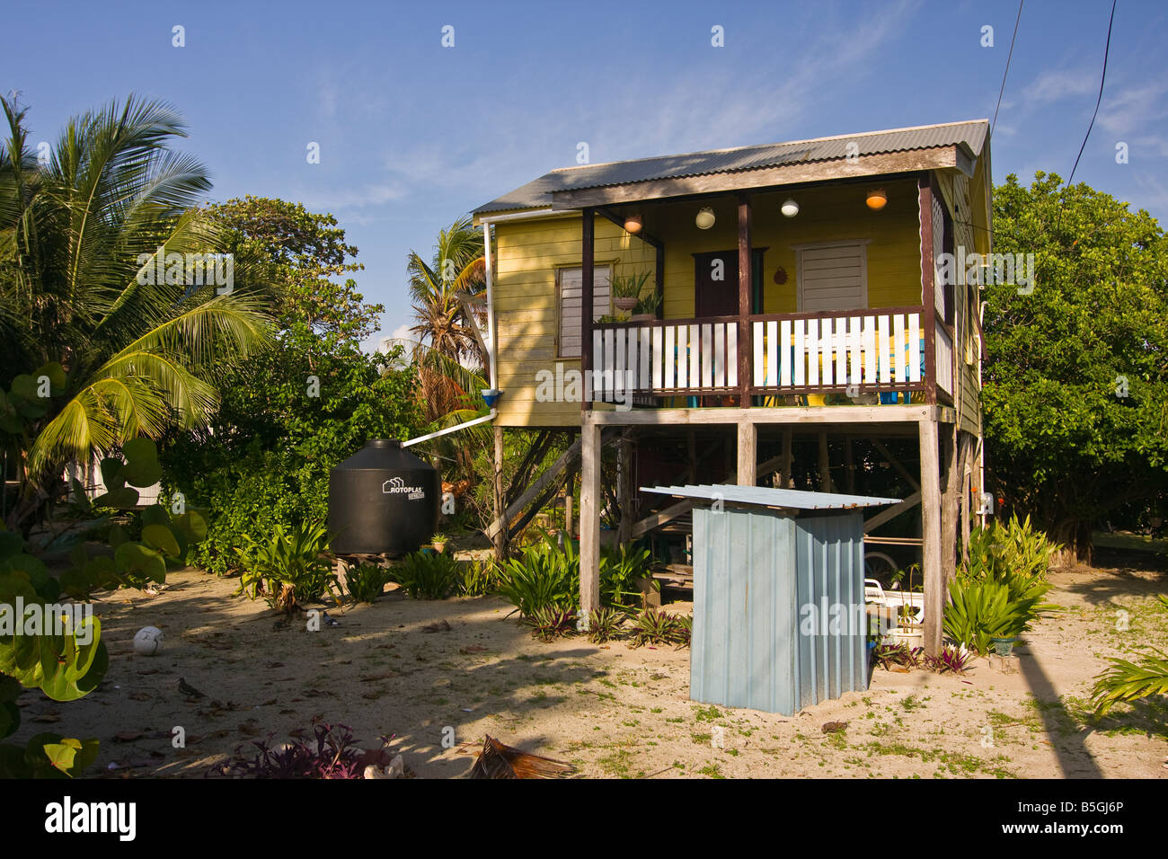 Caye Caulker Belize Small Wooden Cottage On Stilts With