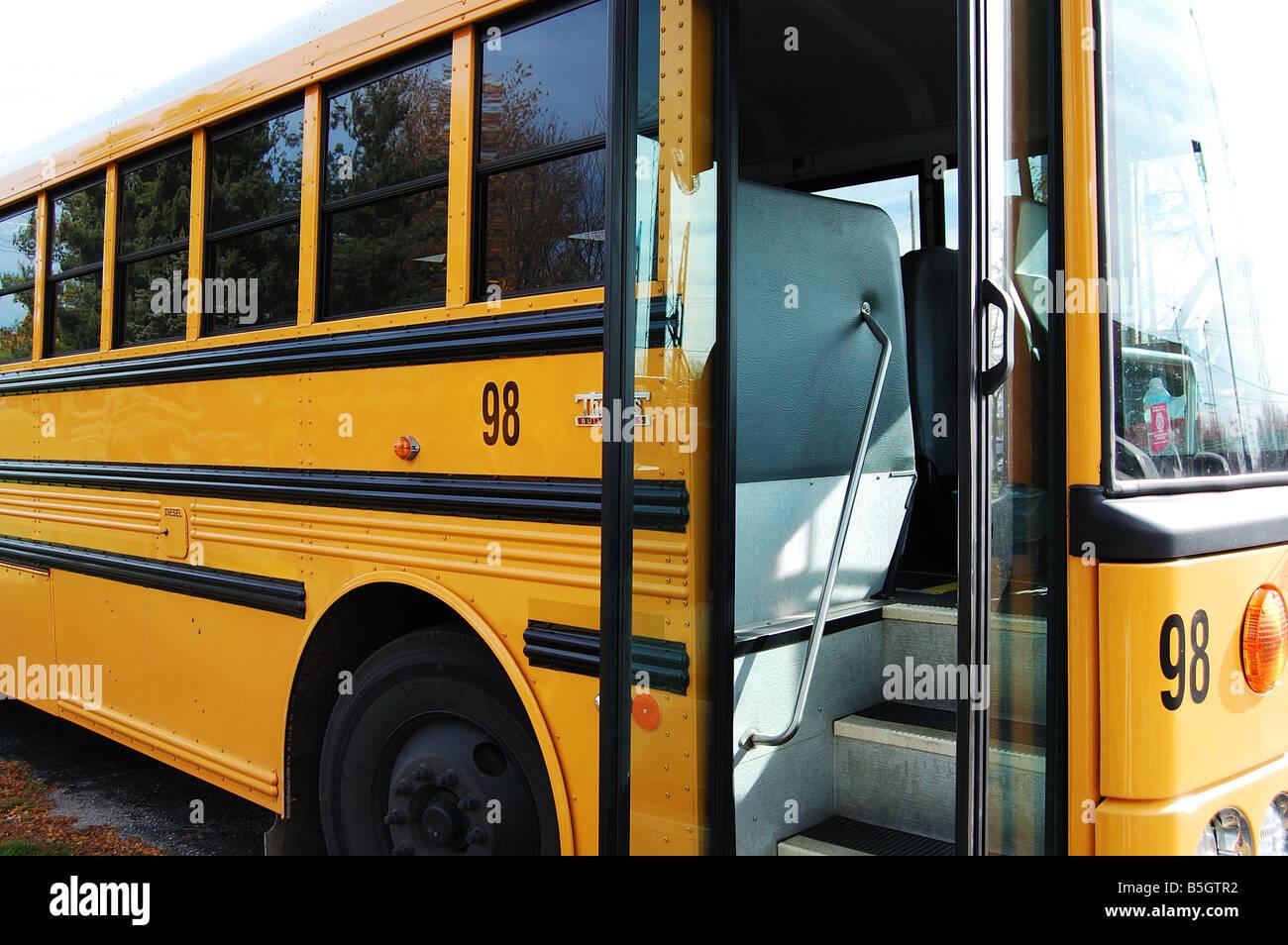 School bus with an open door awaiting students & School bus with an open door awaiting students Stock Photo ...