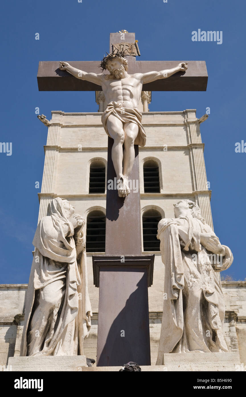 statue of jesus christ on the cross in front of the cathedral