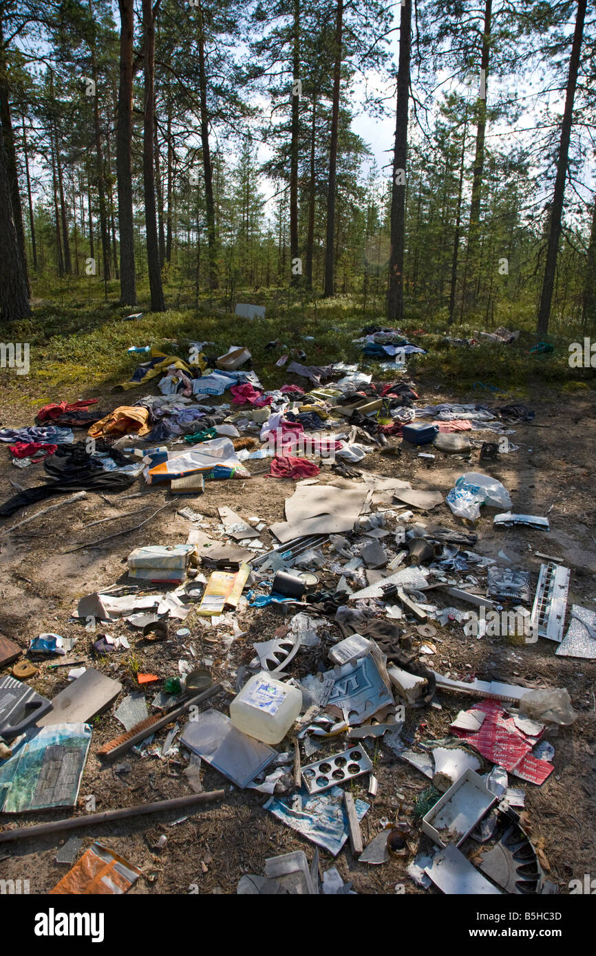 Illegal Trash Dumping Site In The Forest , Finland - Stock Photo