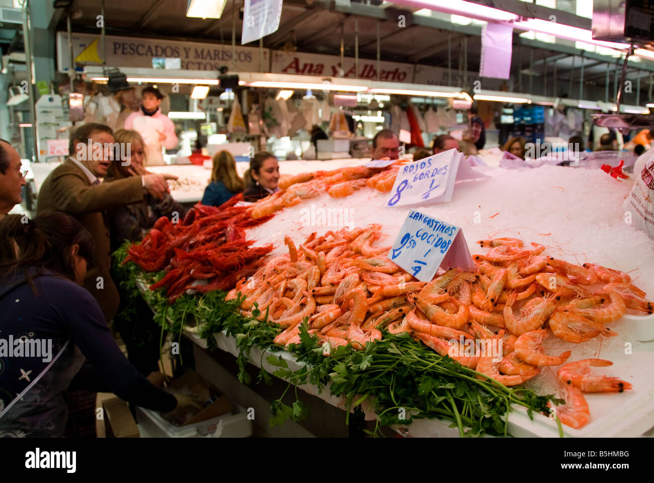 Spanish people buying langoustine in the central fish for Central fish market