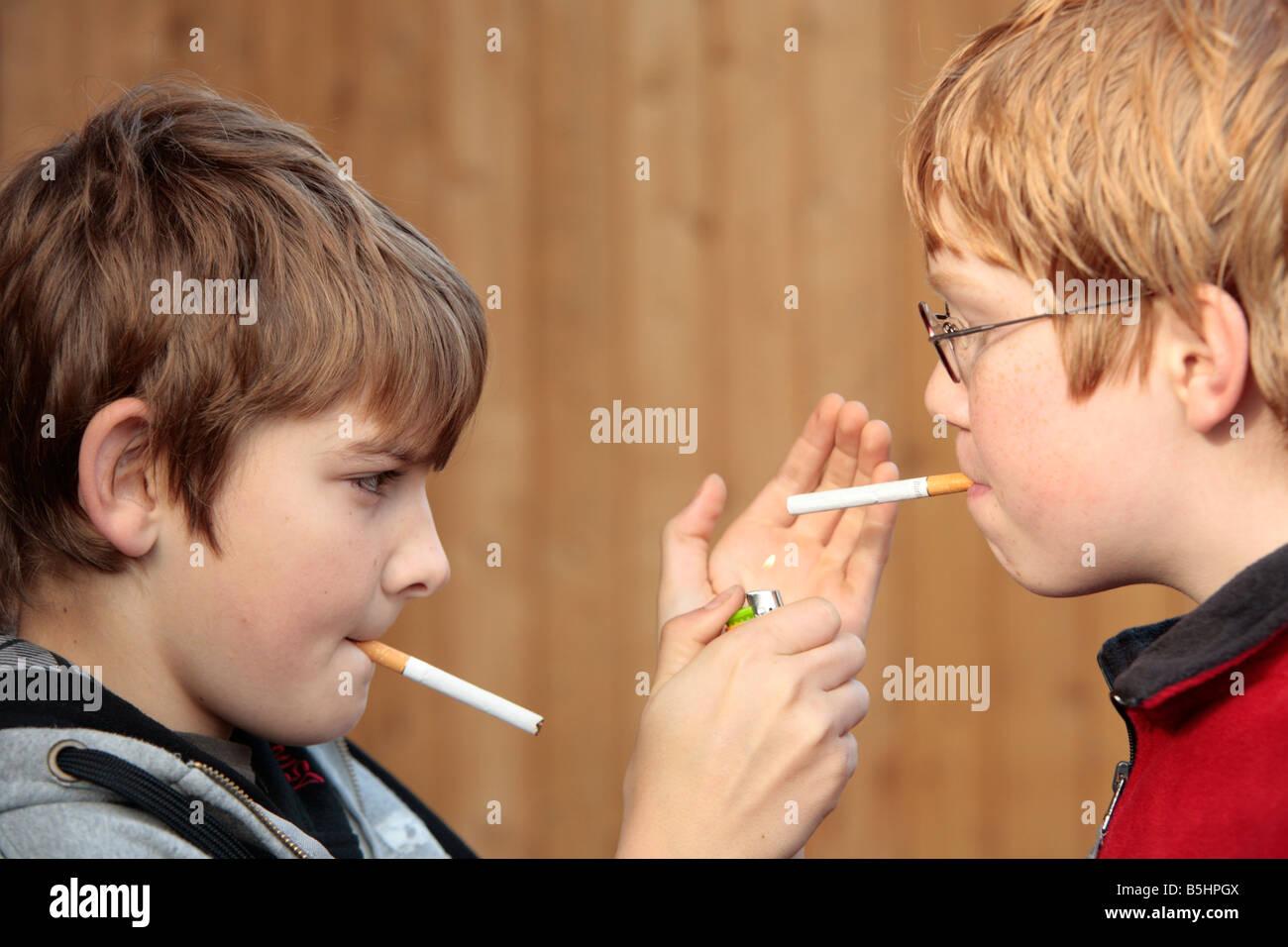 underage smoking Stock Photo - portrait of two underage boys smoking