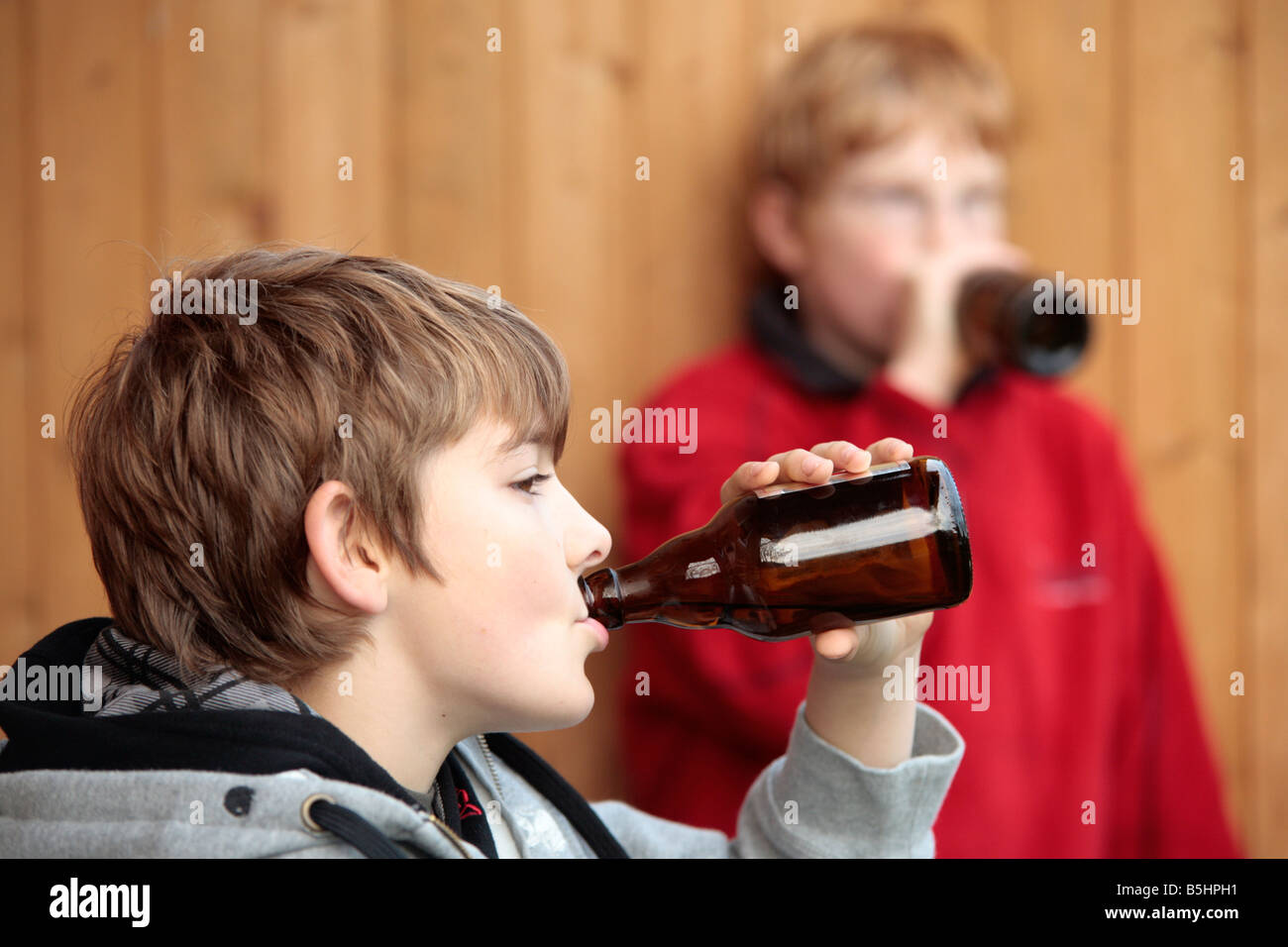 underage smoking Portrait of two underage boys smoking and drinking beer