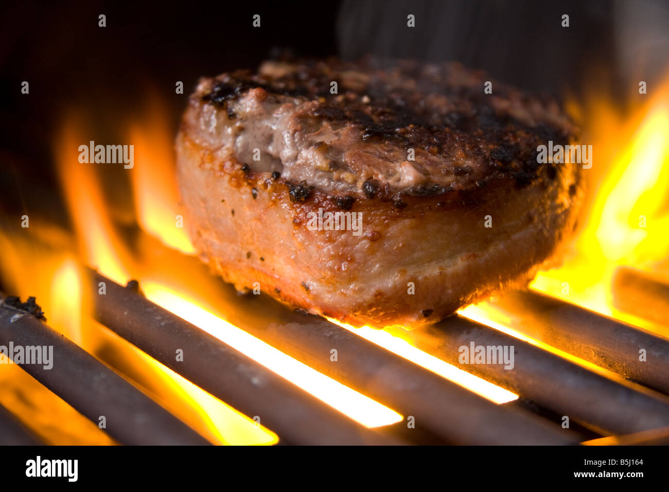 A Bacon Wrapped Beef Tenderloin Filet Cooking On A Gas Grill