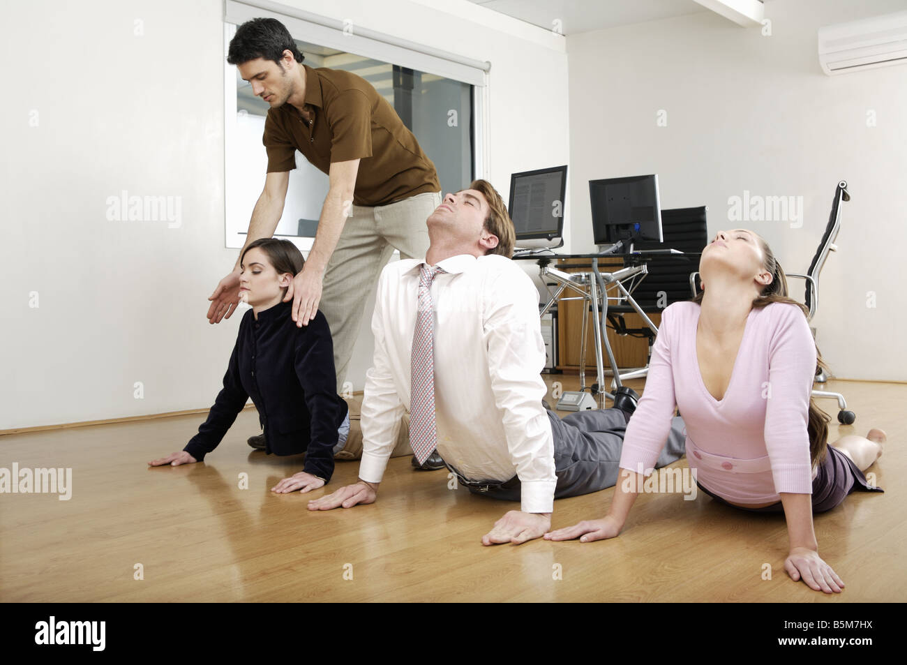Yoga session at business meeting Stock Photo, Royalty Free