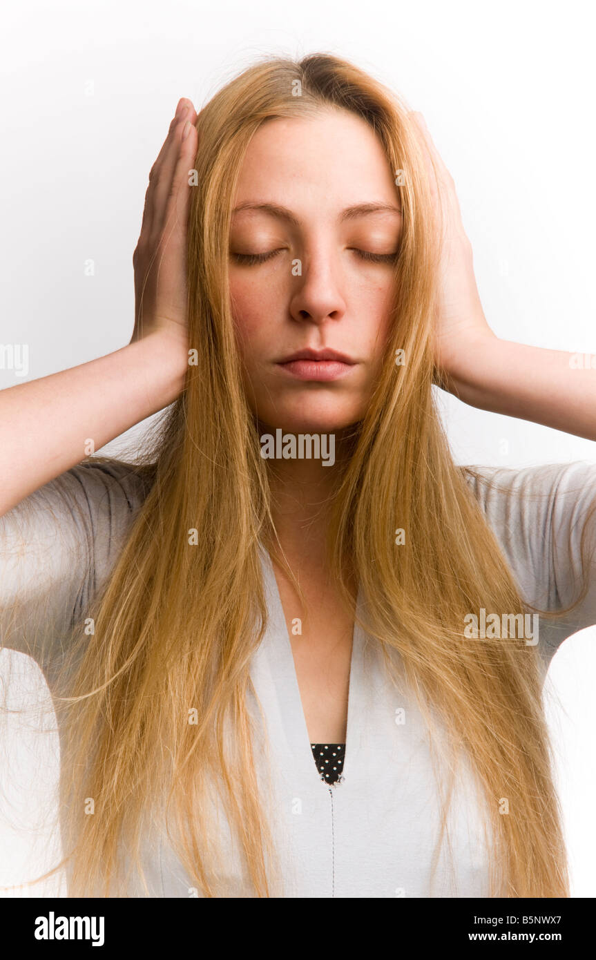 pretty blonde hair young woman covering her ears with her hands ...