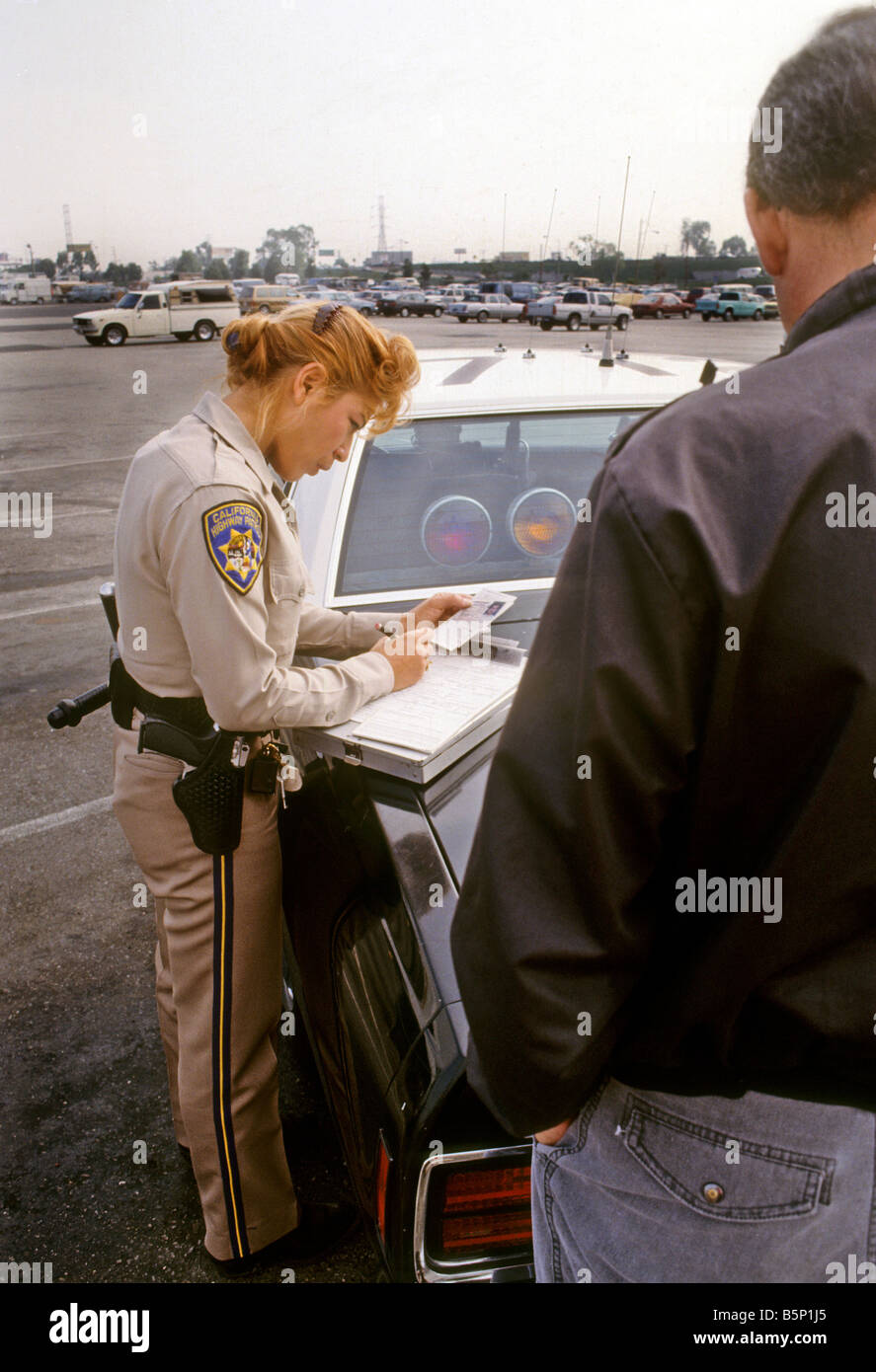 Female California Highway Patrol Officer Writes Citation