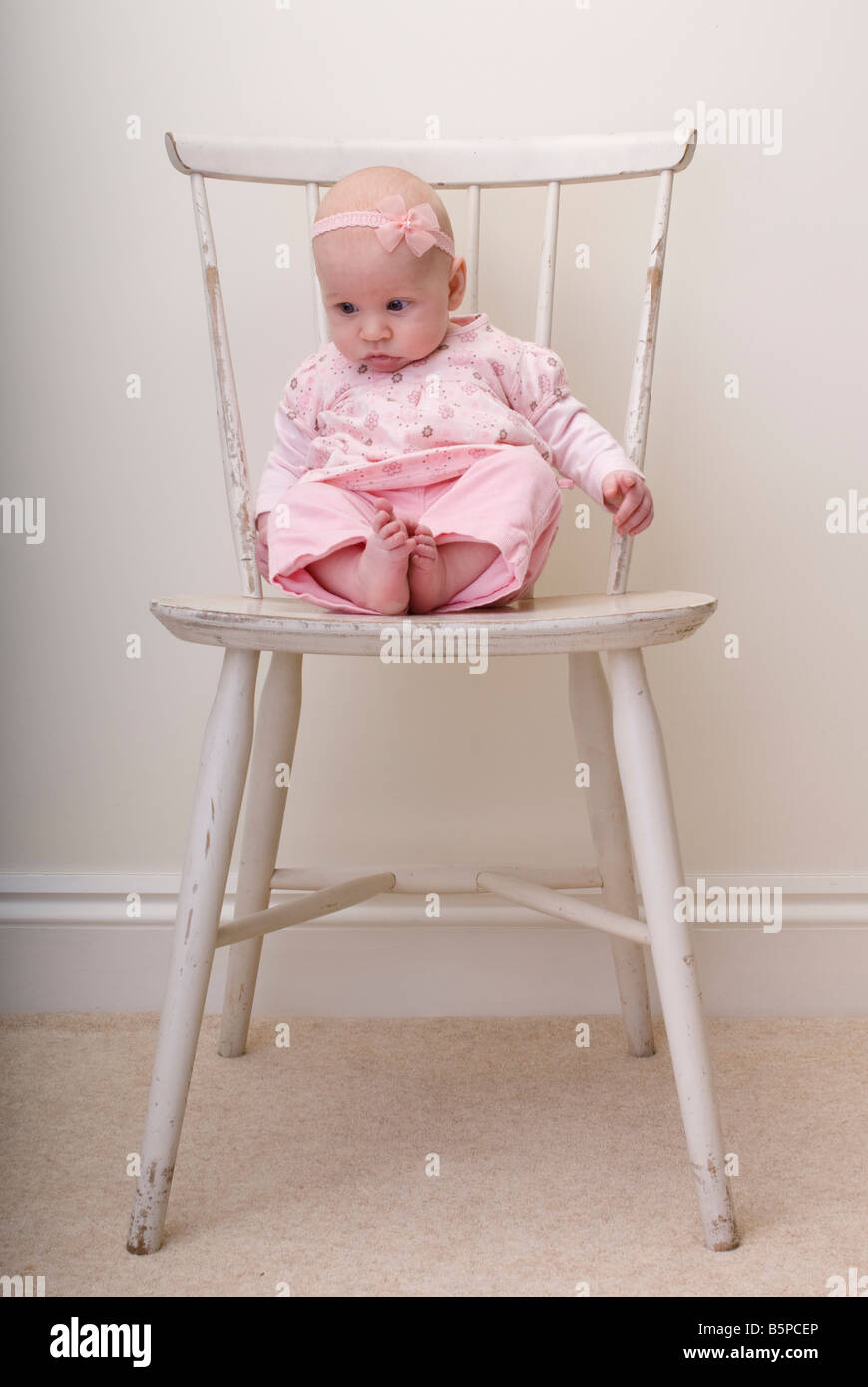 Baby girl sitting on chair stock photo royalty free image for Toddler sitting chair
