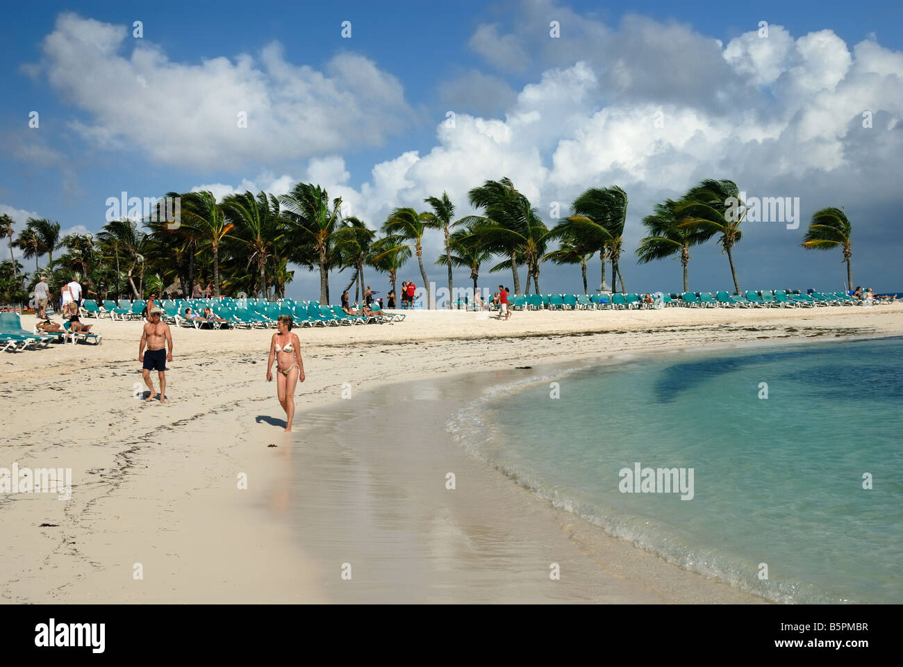 Vacationers Walk The Beach At Little Stirrup Cay Bahamas