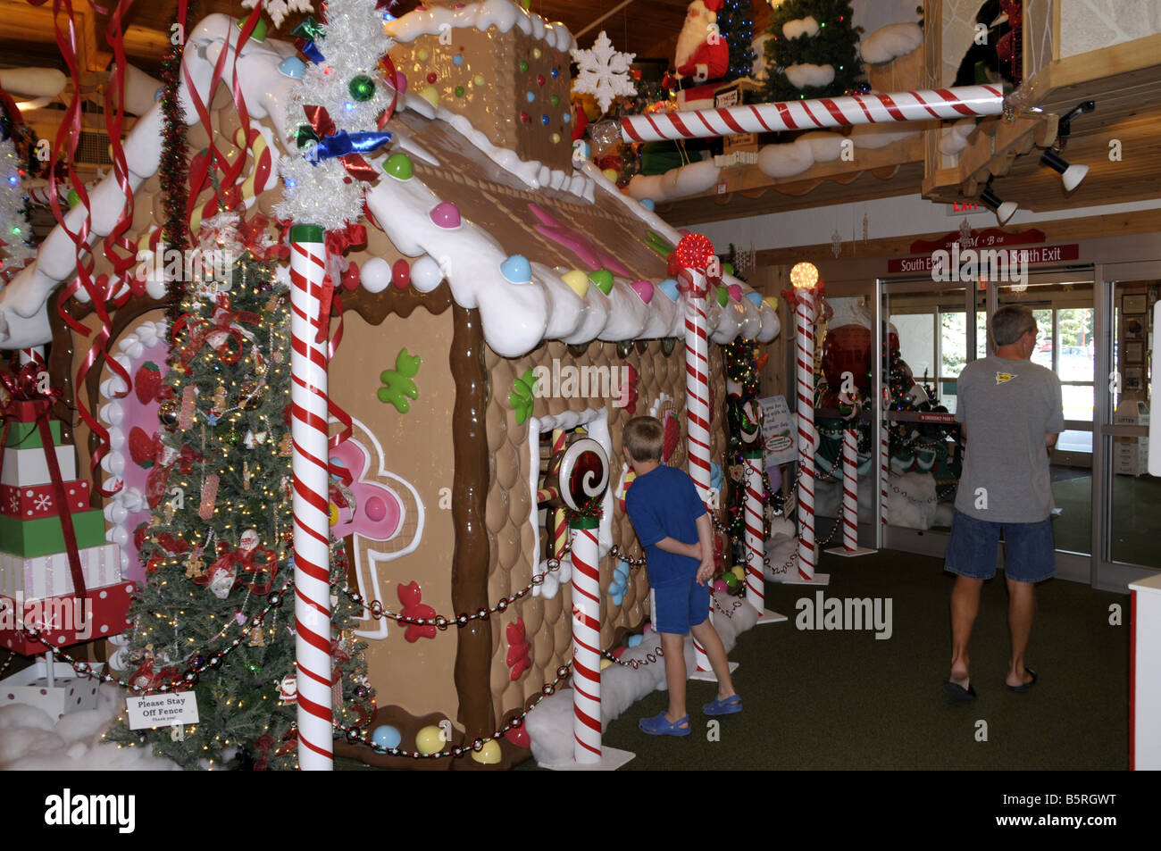 A child looks inside a Christmas house at Bonners Christmas Store ...