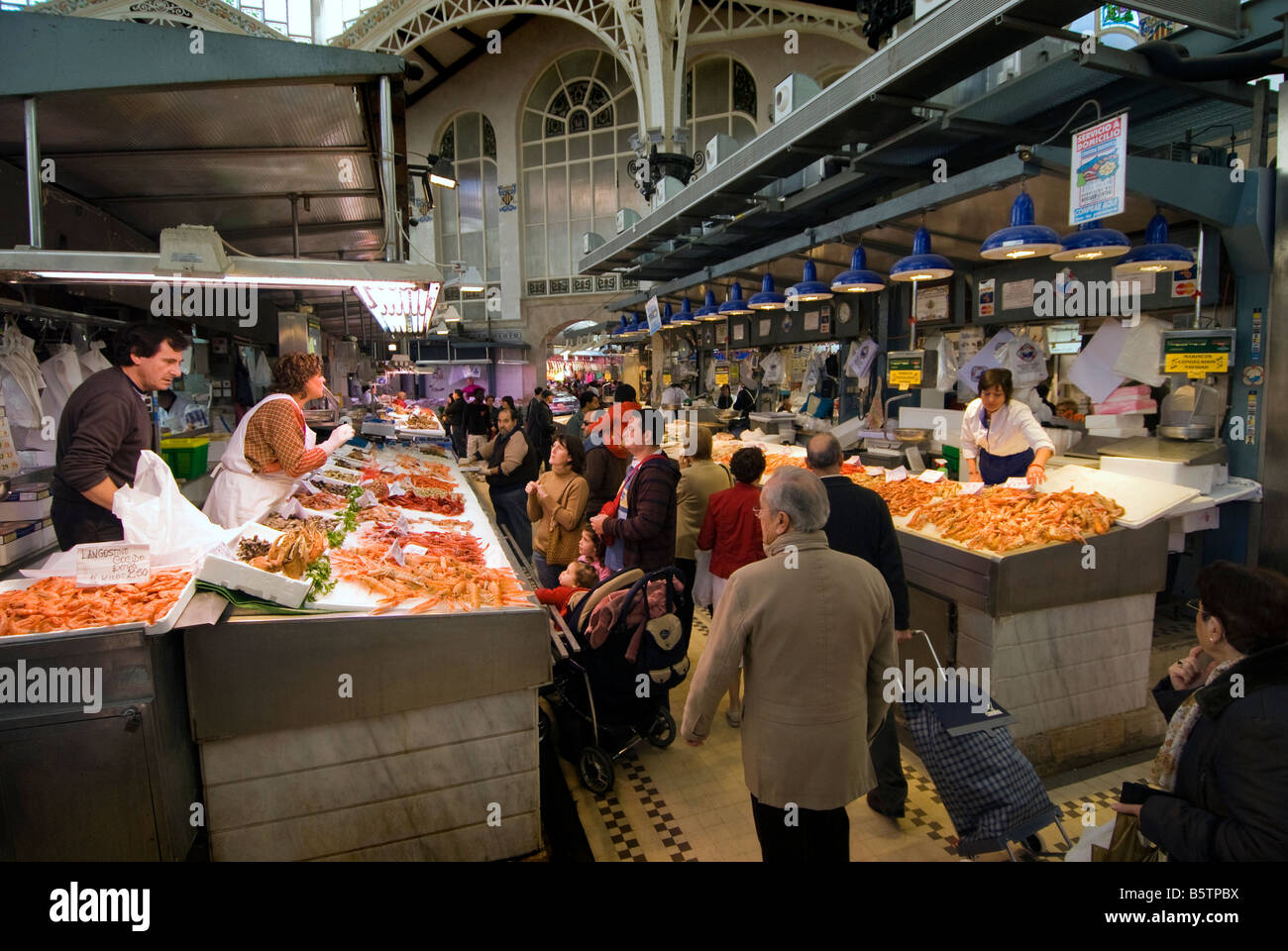 Spanish people buying seafood in the central fish market for Central fish market