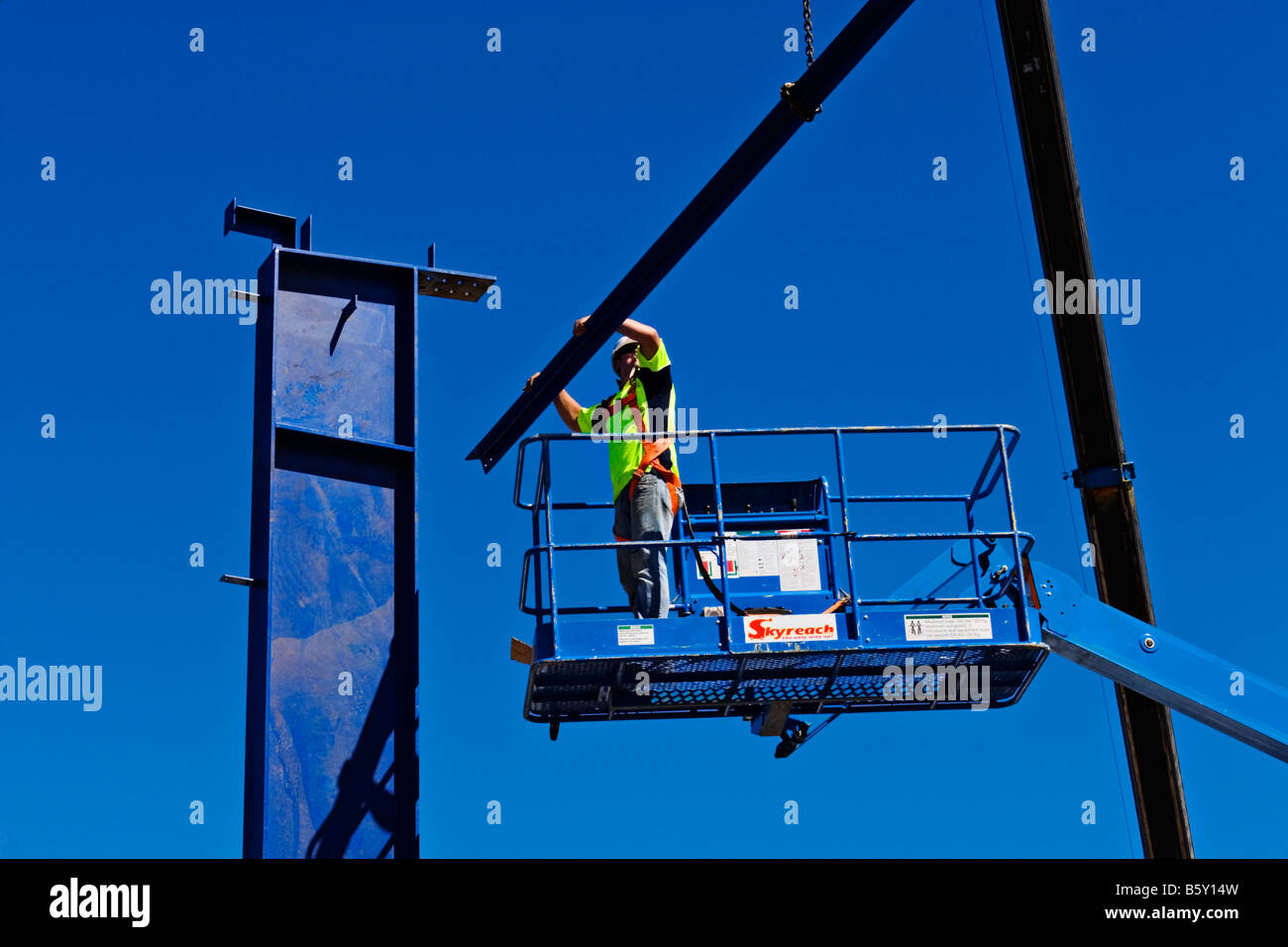 Construction Boom Lift Hydraulic : Construction a worker works safely from