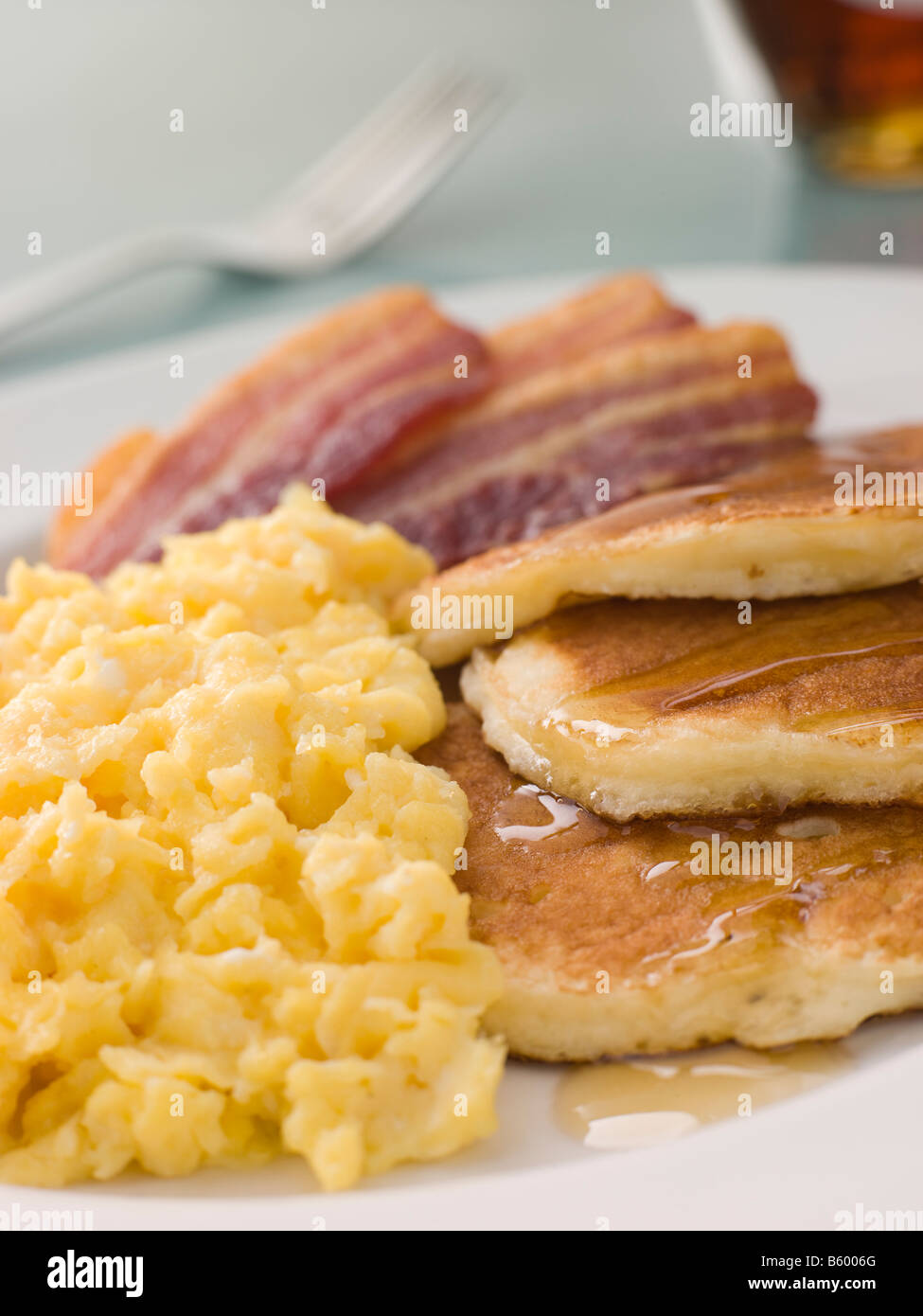 American Pancakes with Crispy Bacon and Scrambled Eggs and ...