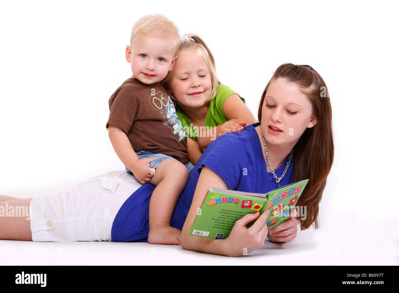 Worksheet Helping Kids To Read a teenage girl is helping two kids learn to read stock photo read