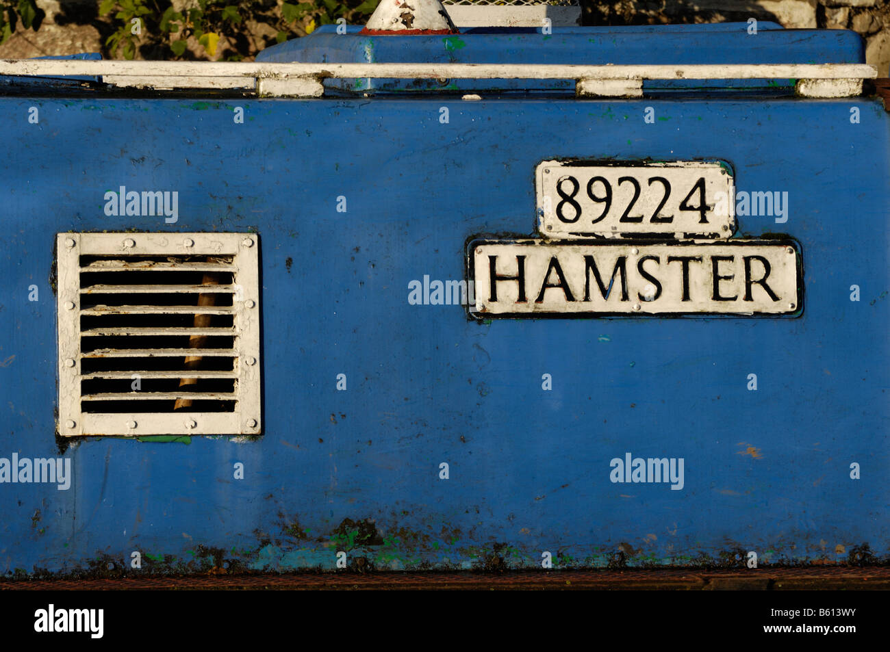 peeling paint and rust on side of english canal-boat, with nameplate