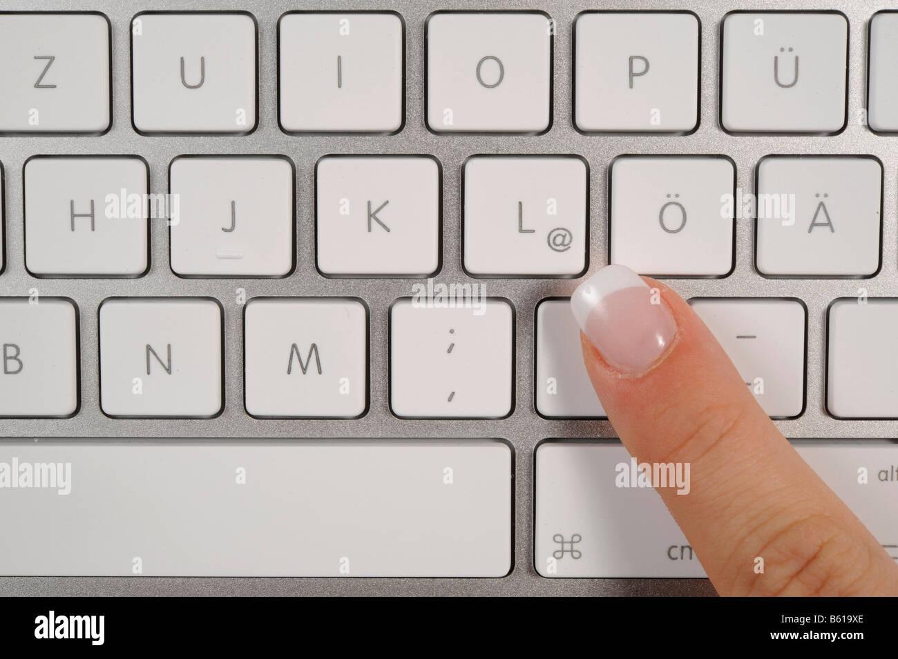Keyboard of an apple macbook pro notebook finger pointing to the keyboard of an apple macbook pro notebook finger pointing to the symbol biocorpaavc Choice Image