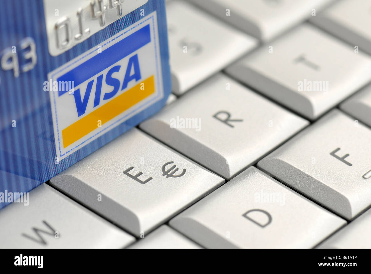 Visa credit card and euro symbol on the keyboard of an apple visa credit card and euro symbol on the keyboard of an apple macbook pro online shopping biocorpaavc Images