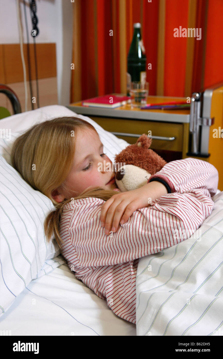 Young girl 7 years old in a hospital bed stock photo for 5 yr old beds