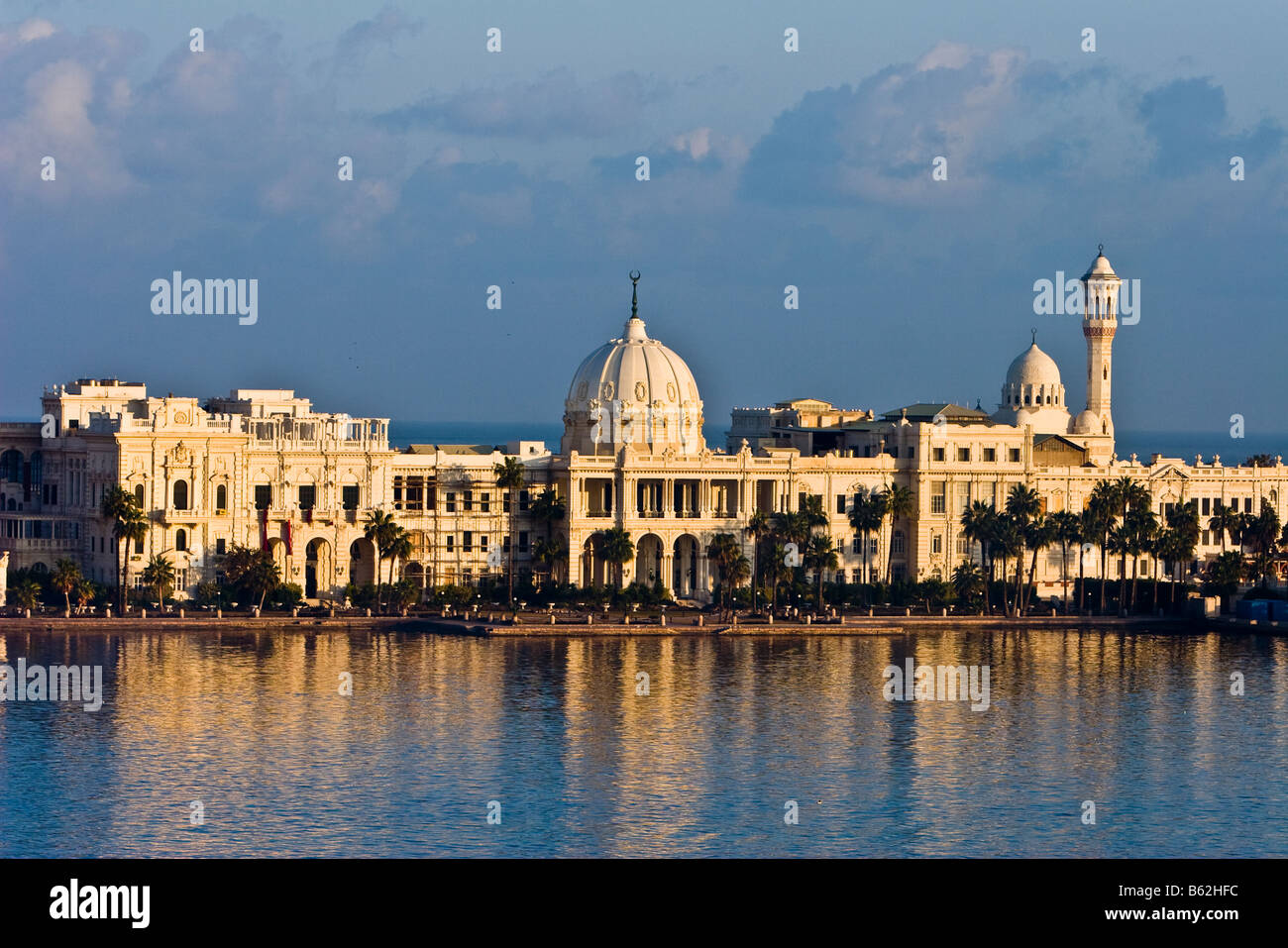 Stock Photo  The Sun Rises On Ras El–tin Palace In Alexandria, Egypt And  Its Reflection Is Cast In The Waters Of The Harbor