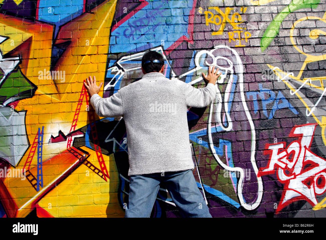 Graffiti wall painting - Stock Photo Brick Painting Spray Paint Train Commuter Valley Graffiti On The Wall Below A Railway Line Art Wallart Community Project Network