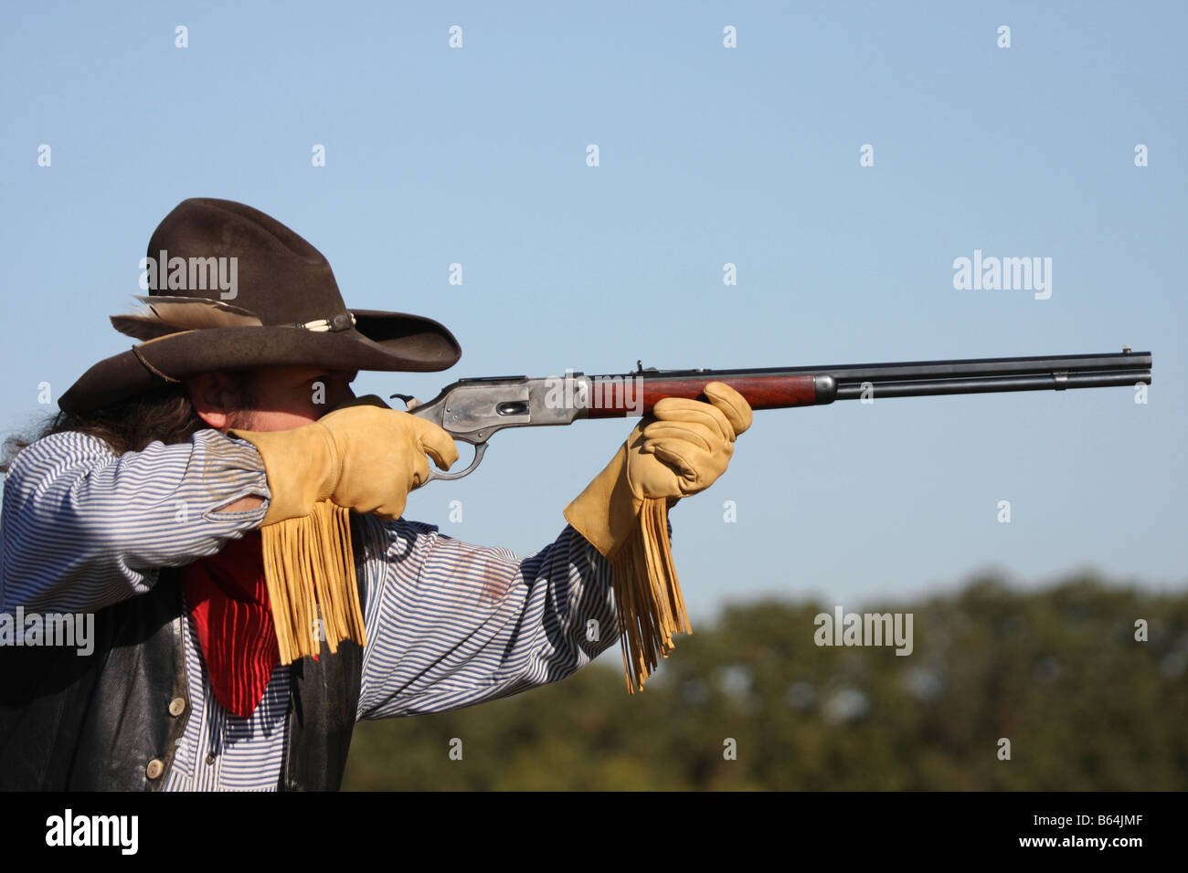 A Cowboy Taking Aim With His Rifle On Horseback In The Old