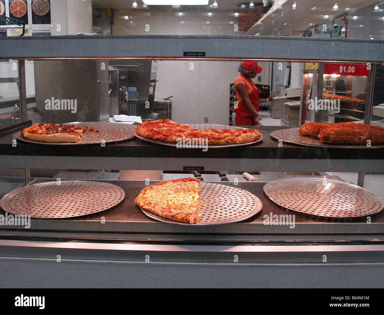 heat lamp food stock photos heat lamp food stock images alamy fast food pizza for at a food concession in a costco whole big box store