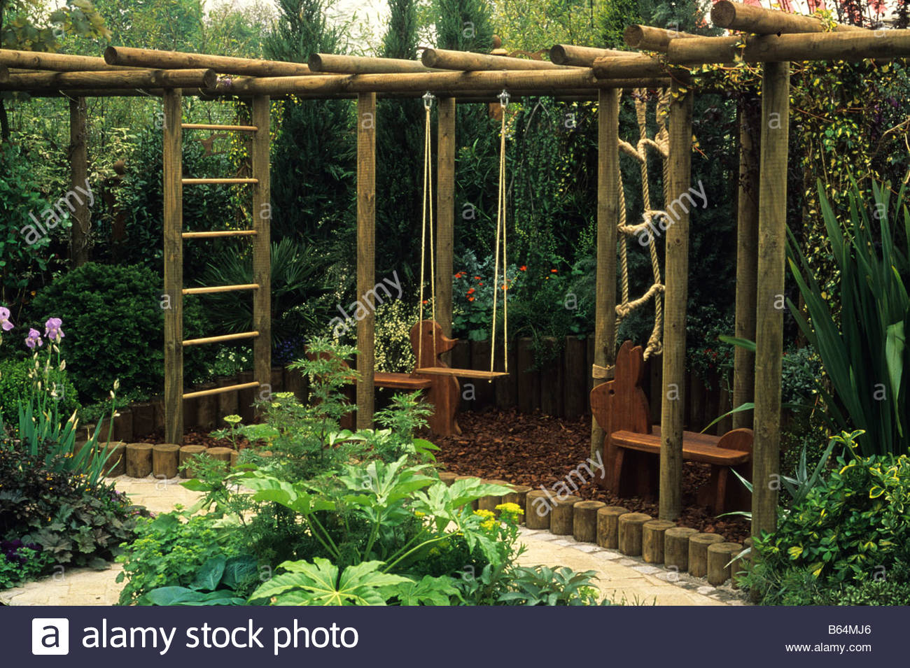 Child friendly wooden climbing apparatus in corner of for Children friendly garden designs